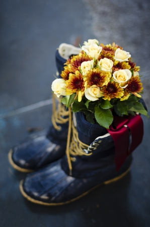 Something blue wedding boots with bouquet inside photo