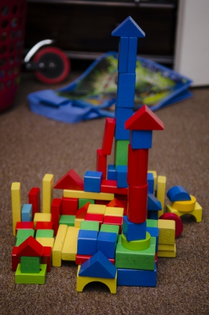 a child s go at engineering   building with coloured wooden blocks