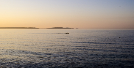 northern ireland: Sea view with canoeist and Island Magee in the background, taken from Bangor Bay, Northern Ireland