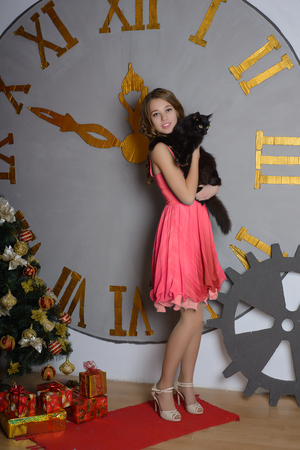 new year cat: Beautiful Girl with Black Cat and Christmas Tree, Christmas Clock, New Year