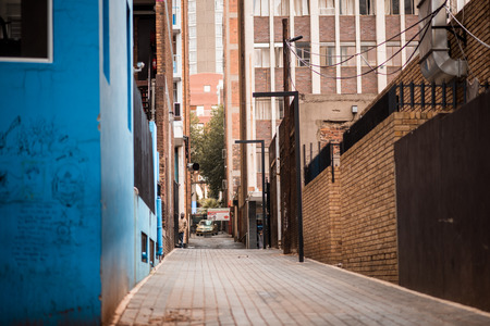 Johannesburg CBD alleyway with blue painted building in foreground