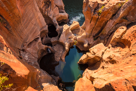 A view looking down on the the plunge pools at Bourke's Luck Potholes in Mpumalanga, South Africa; a geological formation carved out by the movement of water