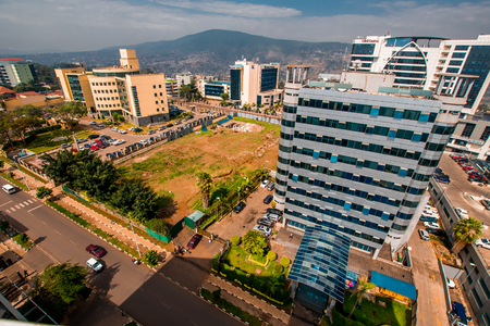Kigali, Rwanda - September 21, 2018: a wide view looking down on the city centre with Ecobank in the foreground surrounded by other buildings against a backdrop of distant blue hills