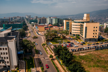 Kigali, Rwanda - September 21, 2018: Clean, well maintained roads and buildings stretch out from the city centre towards a hazy backdrop of blue hills