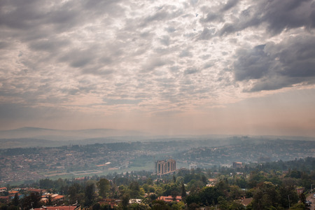 Kigali, Rwanda - September 21, 2018: Sunlight breaks through the clouds over the hills of Rwanda that stretch into the distace Archivio Fotografico