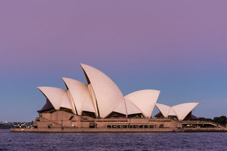 Sydney, New South Wales / Australia - May 13th 2016: Sydney Opera House against a blue and purply sky