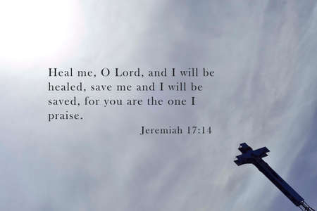 Inspirational verse from the bible on black and white background with wooden cross. Top view and sky background