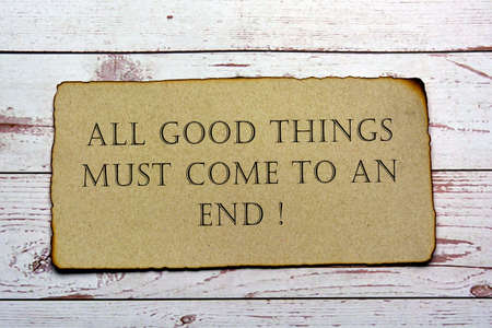 Motivational and inspirational quote on paper with burnt edge - All good things must come to an end