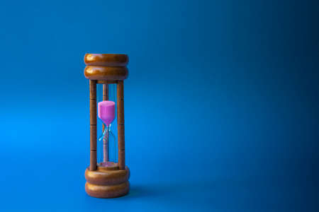 Hourglass as time passing concept for business deadline and running out of time