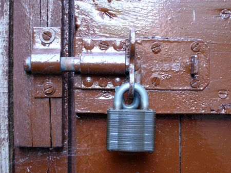 bolted: Bolted door with grey metal padlock