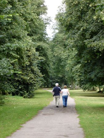 Couple walking in the park Stock Photo