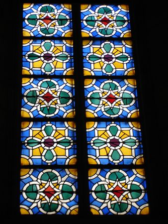 colored glass window in the gothic church