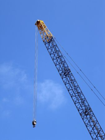Crane against a blue sky photo