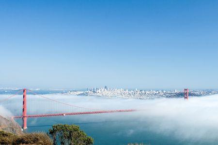 View of the Golden Gate Bridge hidden in clouds photo