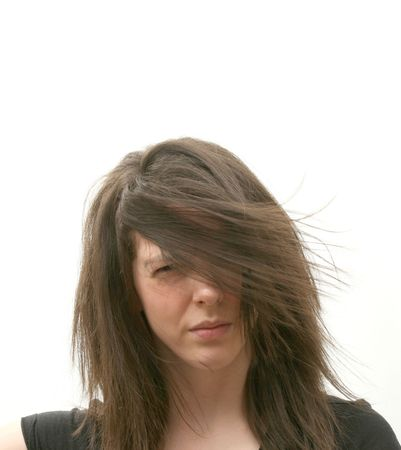 Girl with long hair flying in the wind photo