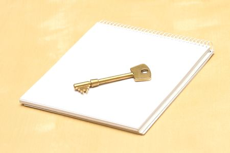 Key and notebook on a table photo