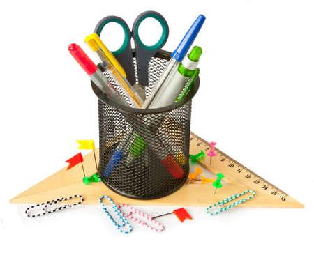 Desktop pen holder full of colored pens on a white background Stock Photo