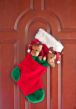 Red christmas sock for presents on the front door