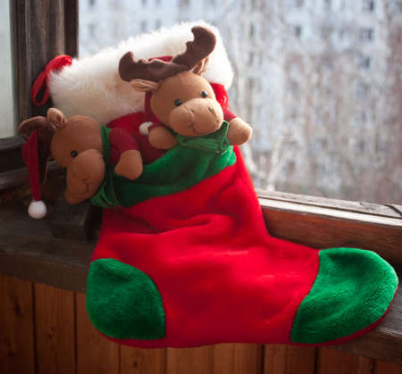 stuffer: Red christmas sock for presents on the window