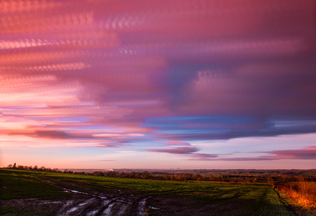 timelapse movement of clouds at sunset with  far reaching scenic landscape