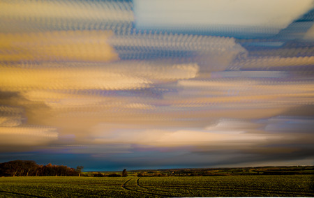 timelapse movement of clouds with long reaching scenic landscape