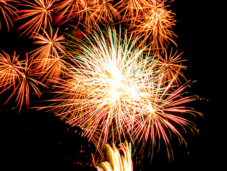 pyrotechnics: Golden star burst and sparkles.Spectacular fireworks  at a national fireworks championship. Three of the UK best firework companies compete with a 10-minute firework display. Stock Photo