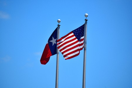 American and Texas Flags Stock Photo