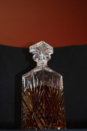 Crystal Liquor Decanter on black background. Stock Photo
