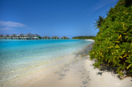 blue lagoon: Water Bungalows of Maldivian Resort with blue lagoon and white beach. Property release. Archivio Fotografico