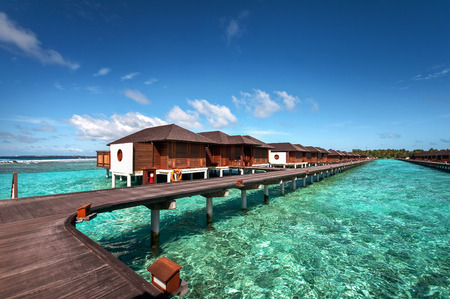 Luxury water villas of the Maldivian resort surrounded by the beautiful blue lagoon