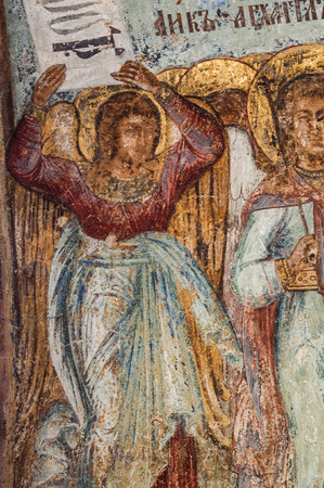 saintliness: Fragment of the Christian mural painting in Thikhvin monastery, Russia.
