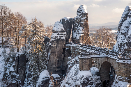 saxon: Bastei bridge in Saxon Switzerland in winter time, covered with snow. Germany Stock Photo
