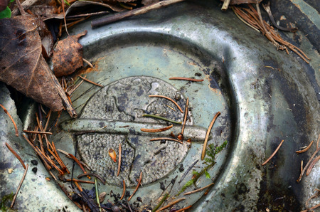 forgotten: An old forgotten hub cap with the Americas stamped on it Stock Photo