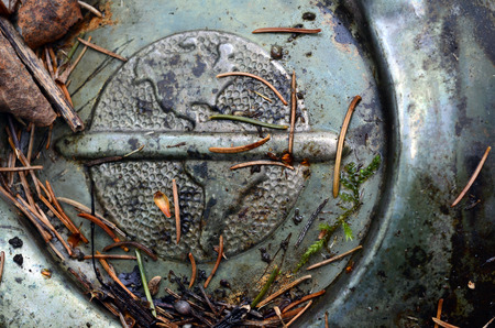 An old hub cap with the Americas stamped on it Фото со стока