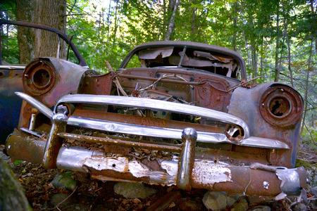 rusty car: Chrome peels from an abandoned car