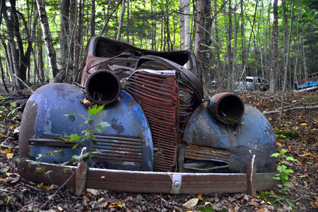 junk car: An abandoned coupe