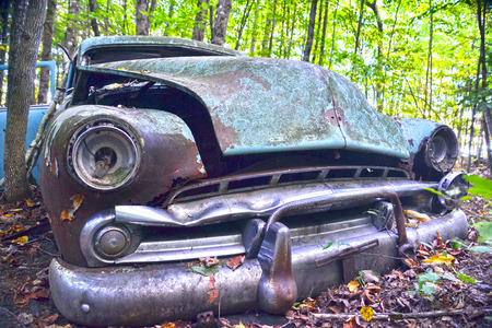 junk car: The nose of an abandoned car
