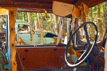 abandoned car: Vista interior de un auto abandonado