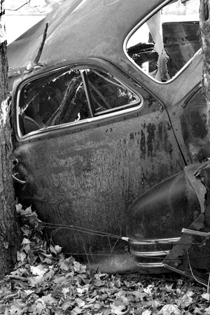 A mangled car body in black and white