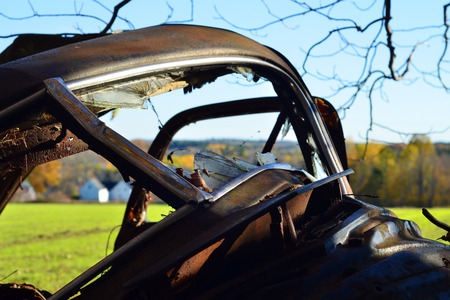 junk car: Through the windshield of an abandoned car