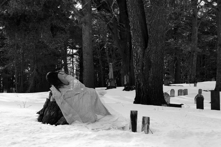 Ghost bride mourns in a cemetary
