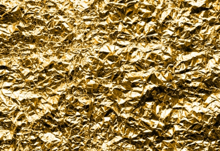 Crumpled Silver Aluminum Foil Background Texture - in Gold Color