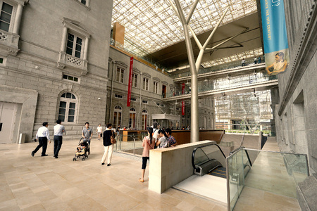 museum visit: Singapore, Dec 1, 2015: Padang Atrium at National Gallery Singapore, the worlds largest public collection of Singapore and Southeast Asian art, located in the Downtown Core of Singapore.