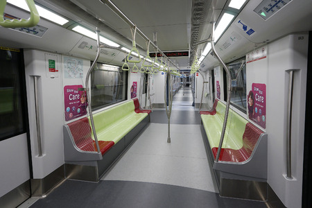 Singapore, Dec 13, 2015: Inside the public transport train in Singapore. The Mass Rapid Transit MRT, forming the major component of the railway system in Singapore, spanning the entire city-state.