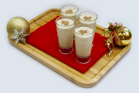 eggnog: Traditional eggnog sprinkled with nutmeg for Christmas and winter holidays.