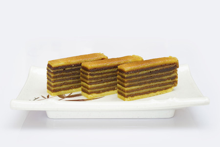 multilayered: Multi-layered cake called lapis legit or spekkoek from Indonesia, isolated on white background.