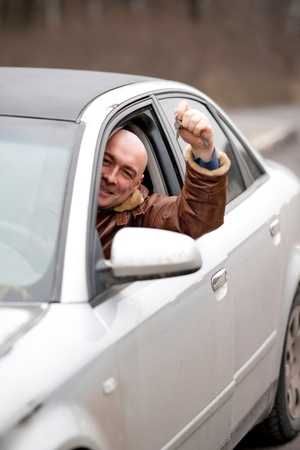 man in the car with keys in a hand Stock Photo - 11764997