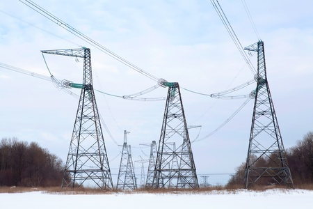 High-voltage columns against the sky photo