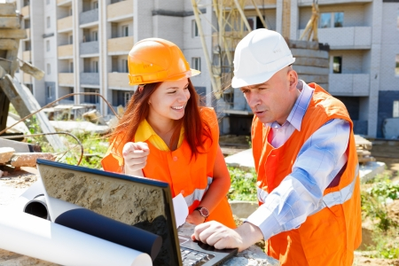 real leader: female and male construction workers Stock Photo