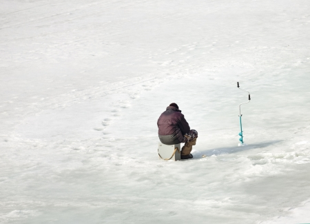 man fishing on the ice Stock Photo - 19383352